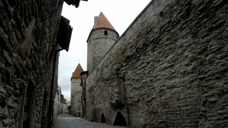 stare miasto : Street and tower of a city wall. Old city. Tallinn, Estonia.