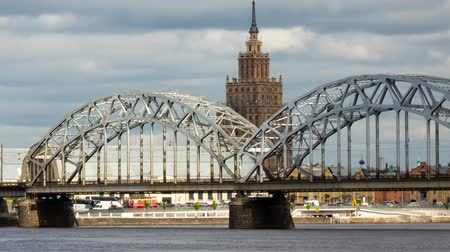riga : view through the Daugava River of the Riga railway bridge and the Building of Academy of Sciences of Latvia, Riga Latvia ,Time-lapse