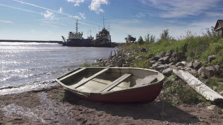 навес : The fishing village on the bank of the North Sea, old boats of fishermen and wooden houses, Russia,Gulf of Finland