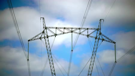 továbbít : Power line support against the background of the blue sky with clouds