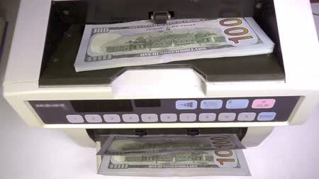 euro banknotes : Electronic money counter machine is counting is counting the American hundred-dollar US dollars banknotes Stock Footage
