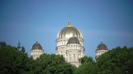 империя : Nativity of Christ Cathedral, Riga, Latvia was built to design by Nikolai Chagin and Robert Pflug in a Neo-Byzantine style between 1876 and 1883, during period when country was part of Russian Empire Стоковые видеозаписи