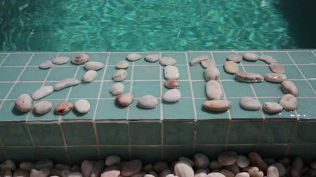 отдыха : Celebration of new year,Date 2019 is laid out by pebble stones on the edge of the pool in the tropical resort