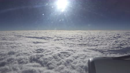 пространство : top view on white clouds from the plane. Traveling by air.