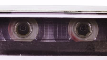 ses : Audio cassette tape in use sound recording in the tape recorder. Vintage music cassette with a blank white label, playing back in the player