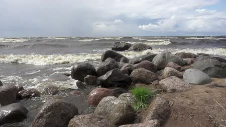 raiz : Slow Motion .Waves of the sea break against stones. Gulf of Finland