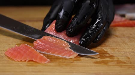 filet : Chef cuts trout fillet into thin slices with a special knife, closeup Stock Footage