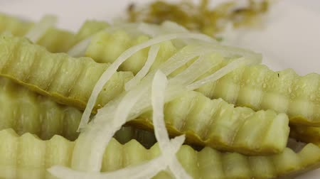pickled : Beautifully sliced fermented cucumbers with onions rotate clockwise, close-up