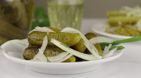 kapor : Fermented cucumbers sprinkled with chopped white onions, close-up