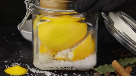 crush : The chef squeezes the juice from two lemons with a wooden press for further fermentation
