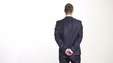 spunk : body language. man in business suit isolated white background. Training managers. sales agents. gesture of confidence. hands behind his back