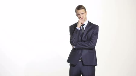 düşünceli : gestures distrust lies. body language. man in business suit isolated on white background. closed position. closes mouth by hand. his arms
