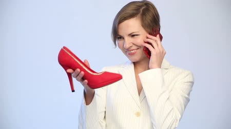 high heels : woman chooses shoes. phone calls. Stock Footage