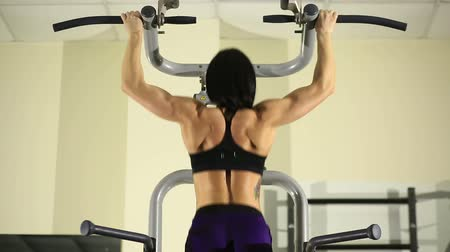bicep : Fitness girl doing pull-ups Stock Footage