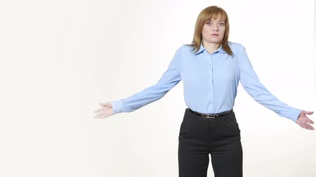 bewilderment : gesture Shrug. girl in pants and blous.  Isolated on white background. body language. women gestures. nonverbal cues