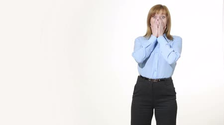 dismay : girl covering her mouth with her hands. girl in pants and blous.  Isolated on white background. body language. women gestures. nonverbal cues