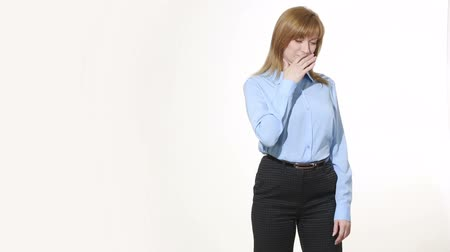 ídolo : insincere gesture. mouth is closed with one hand. girl in pants and blous.  Isolated on white background. body language. women gestures. nonverbal cues