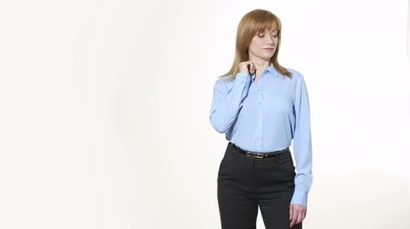 ídolo : touching the ear. lies gesture. girl in pants and blous.  Isolated on white background. body language. women gestures. nonverbal cues Stock Footage