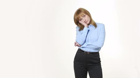 blúz : Backs cheek with his hand. girl in pants and blous.  Isolated on white background. body language. women gestures. nonverbal cues