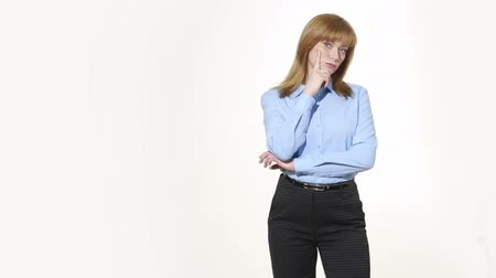 incredulity : finger to his cheek. decision and skepticism. girl in pants and blous.  Isolated on white background. body language. women gestures. nonverbal cues