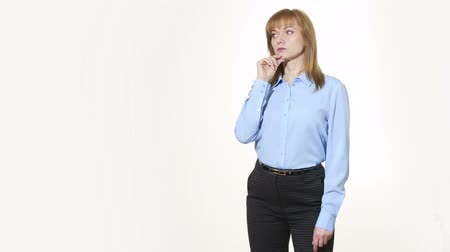 incredulity : chin stroking. decision and skepticism. girl in pants and blous.  Isolated on white background. body language. women gestures. nonverbal cues Stock Footage