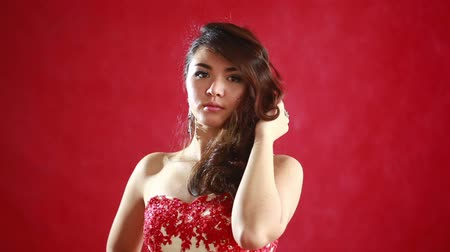 красные волосы : Beautiful asian woman model portrait in hot red dress.
