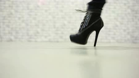 high heels : Female legs walking in high heel shoes.