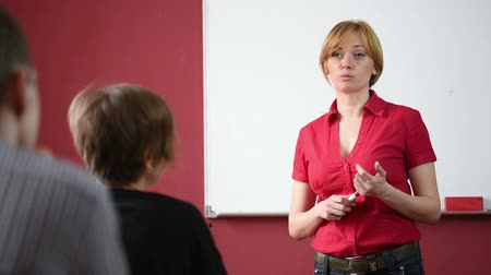 лекция : female teacher giving a lecture at the University