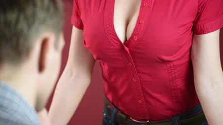 лекция : Educational theme: portrait of a teacher giving a lecture. Sexy Busty teacher in front of male students. demonstrates chest