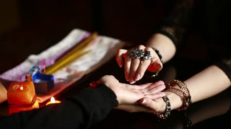astrologist : Witch - fortune teller reading fortune. palmistry