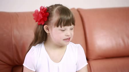aşağı : Emotions of a little girl with Down syndrome. disabled girl laughs Stok Video