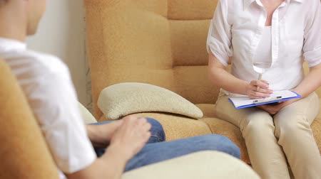 counselling : man talking with his therapist at therapy session