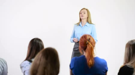 conference centre : Beautiful business woman is speaking on conference. Stock Footage