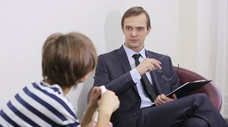 counsel : pretty male psychiatrist looking at patient during her visit
