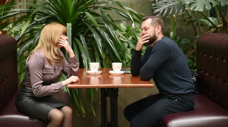 étkező : man and woman in a cafe. drink coffee. a business meeting