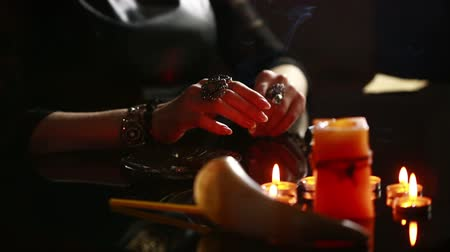 palmist : Witch - fortune teller with candles close up. magic ritual. divination