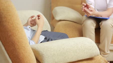 counsel : female psychologist with the boy. Stock Footage