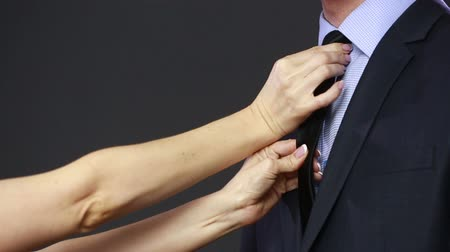 suit and tie : girl straightens his tie to her husband. Stock Footage