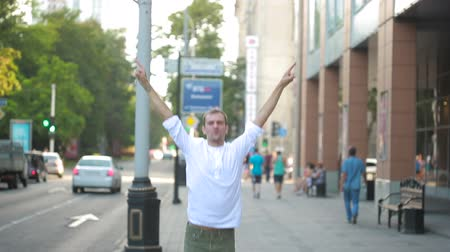 radość : man jumping for joy in the streets. overjoyed.