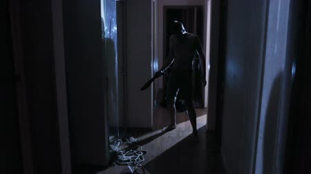 machete : two zombies maniac with a knife down the hallway. horror
