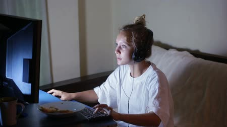 toco : young woman playing video games on your computer. rabid gamer. I lost the game