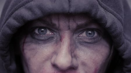 bruising : mad eyes of an evil man. Dirty face in blood. head in the hood Stock Footage