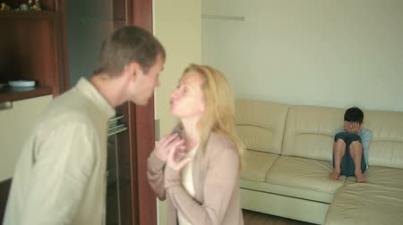 país : parents quarrel with his son. mother and father arguing. stress in a child