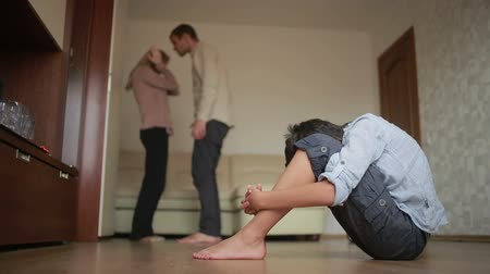 país : boy is present at a quarrel parents. father beat her mother. stress in a child