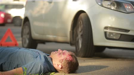 fatality : man had a car accident. head smashed. pedestrian injured in road accidents