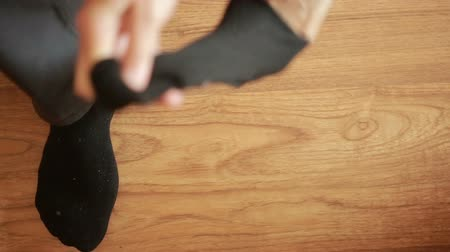 носить : Man putting socks. man removes socks. close-up