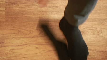ношение : Man putting socks. man removes socks. close-up