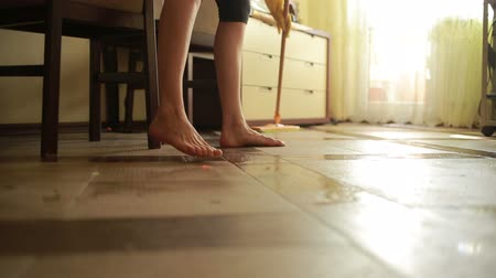 besom : Woman makes cleaning. girl cleaning the floor mop. cleaning Stock Footage