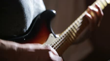 jazzman : Hands of man playing electric guitar. Bend technique. rock musician