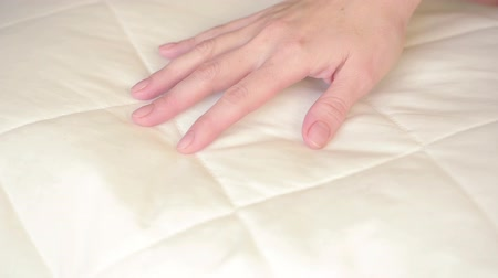 almofada : female hand pressing on the pillow. soft pillow